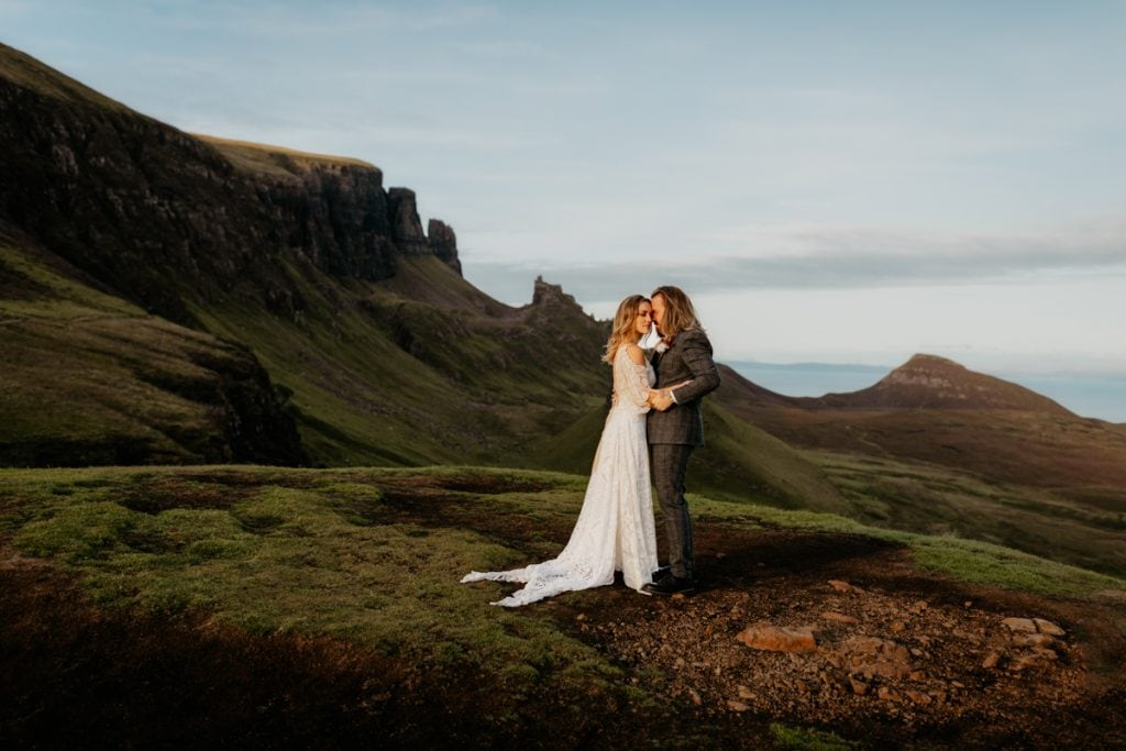 Wedding couple embrace during ceremony at the Quiraing, Isle of Skye