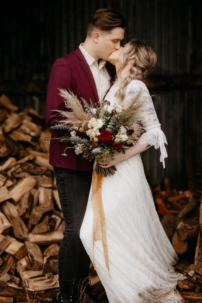 Scotland woodland elopement couple kissing in a wood shed