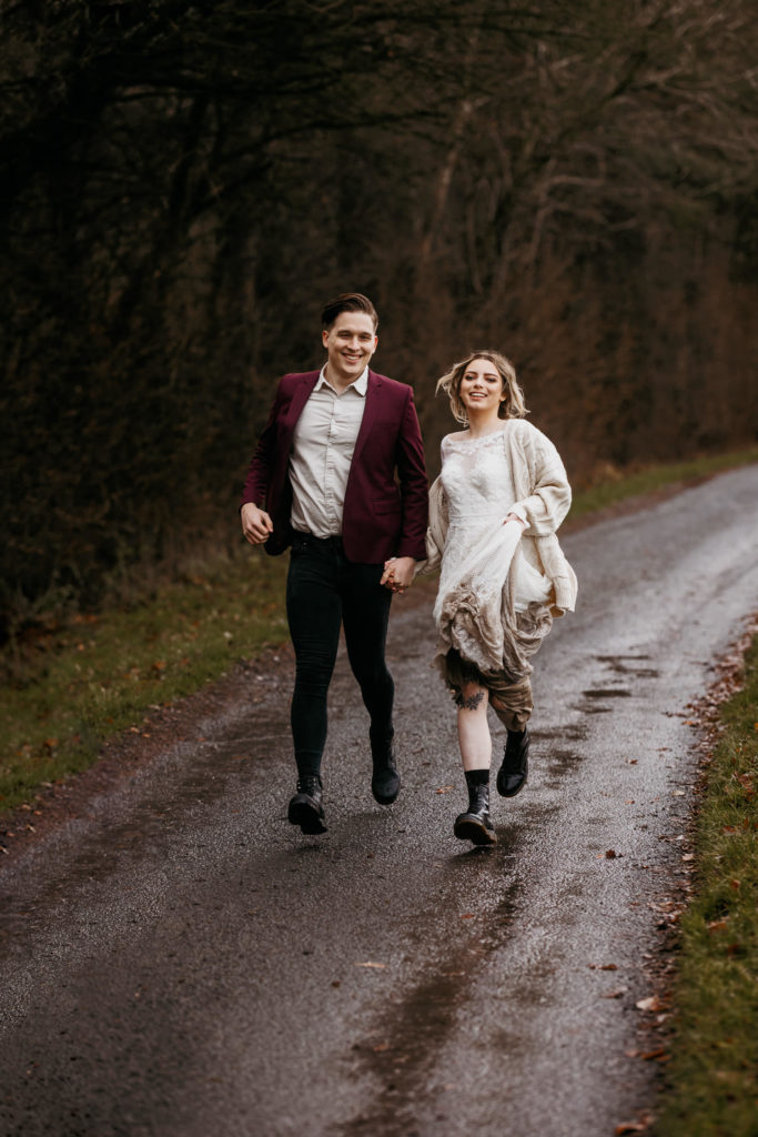 Scotland woodland elopement running couple on a path