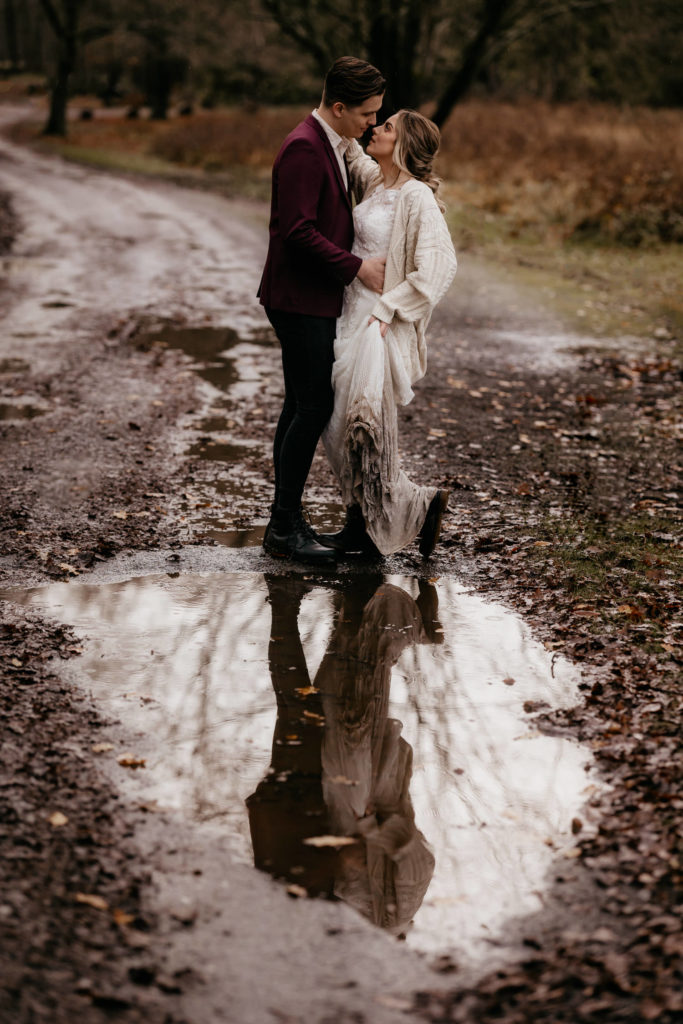 Scotland woodland elopement couple embracing with reflection