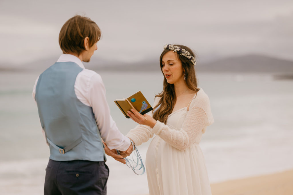 Couple reading vows during elopement on Scarista beach Isle of Harris