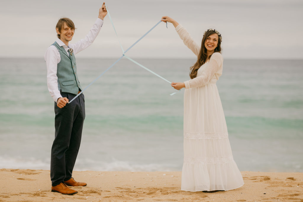 Eloping couple tying the know, Isle of Harris white sand beach, Outer Hebrides
